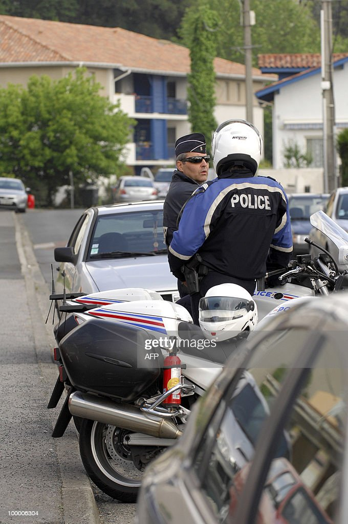 French policemen stand guard on May 20, 2010 in front of a house in the southwestern French city of Bayonne where detectives and anti-terrorist police raided today to arrest the suspected military chief of the Basque separatist group ETA, Mikel Karrera Sarobe at daybreak. Sarobe, alias Ata or 'duck' in the Basque language, was identified as ETA's new military leader on a revised most-wanted list issued by Spanish police late March 16 in their pursuit of ETA militants.