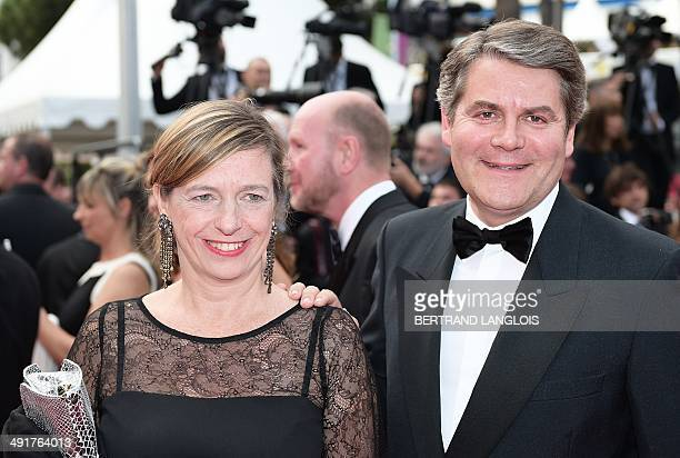 French political advisor Franck Louvrier and his wife pose as they arrive for the screening of the film 'SaintLaurent' at the 67th edition of the...