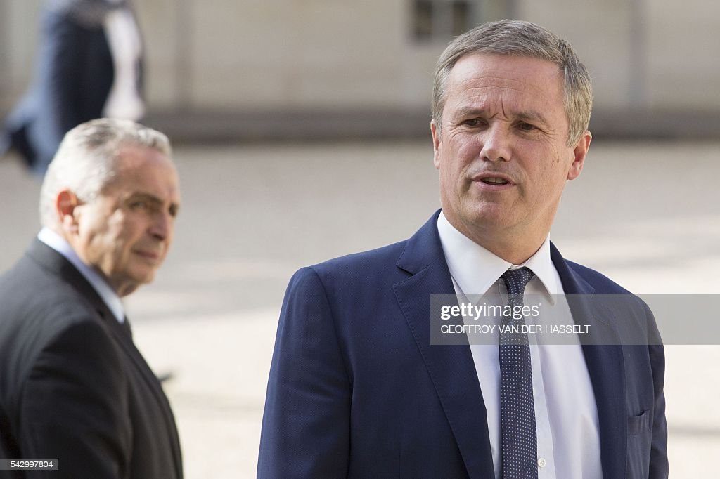 French political party Debout la France (DLF) president Nicolas Dupont-Aignan leave after a meeting with French President on June 25, 2016 at the Elysee Palace in Paris, after Britain voted to leave the European Union a day before. Europe's press was awash with gloom and doom over Brexit on June 25, warning that it was a boon for nationalists while urging EU leaders to meet the challenge of their 'rendezvous with history'. / AFP / GEOFFROY