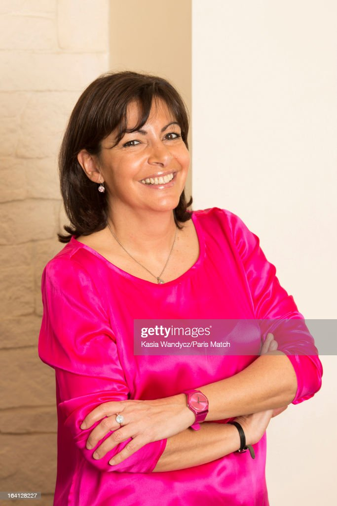 French politican and member of the Socialist party who is running for the post of mayor of Paris, <a gi-track='captionPersonalityLinkClicked' href=/galleries/search?phrase=Anne+Hidalgo&family=editorial&specificpeople=590989 ng-click='$event.stopPropagation()'>Anne Hidalgo</a> is photographed at home with her husband Jean-Marc Germain for Paris Match on March 9, 2013 in Paris, France.
