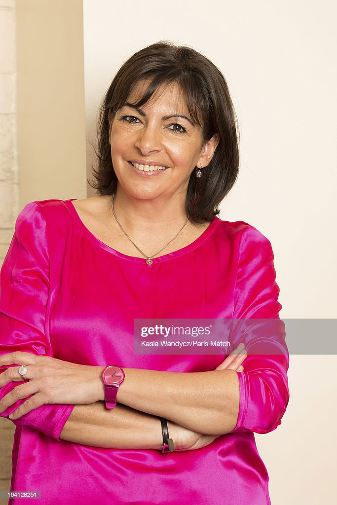 French politican and member of the Socialist party who is running for the post of mayor of Paris, Anne Hidalgo is photographed at home with her husband Jean-Marc Germain for Paris Match on March 9, 2013 in Paris, France.