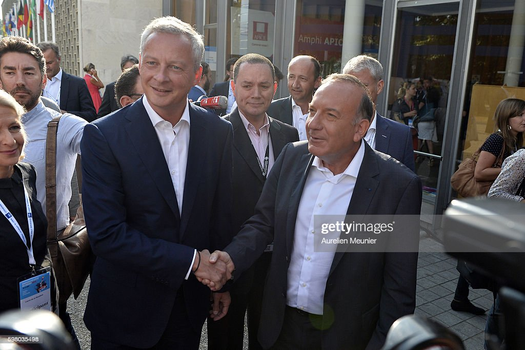 French politician and Presidency candidate Bruno Le Maire is welcomed by Pierre Gattaz President of the Medef before he addresses hundreds of...
