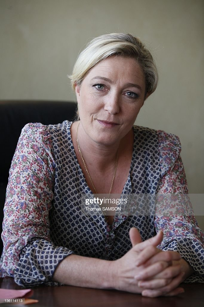 French politician and president of Front National <a gi-track='captionPersonalityLinkClicked' href=/galleries/search?phrase=Marine+Le+Pen&family=editorial&specificpeople=588282 ng-click='$event.stopPropagation()'>Marine Le Pen</a> is pictured in her office at far-right party headquarter on July 8, 2011 in Nanterre, France.