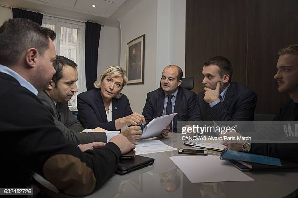 French politician and president of the National Front Marine Le Pen is photographed at campaign headquarters with Bruno Bilde Sebastien Chenu David...