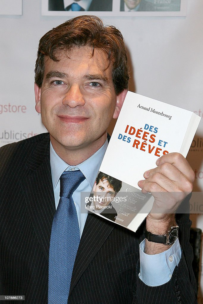 French politician <a gi-track='captionPersonalityLinkClicked' href=/galleries/search?phrase=Arnaud+Montebourg&family=editorial&specificpeople=588268 ng-click='$event.stopPropagation()'>Arnaud Montebourg</a> dedicates his new book 'Des idees et des reves' at Drugstore Publicis on January 5, 2011 in Paris, France.