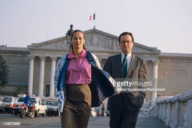French politician Francois Hollande and his wife Segolene Royal in front of the National Assembly are photographed for Paris Match on June 20 1988 in...