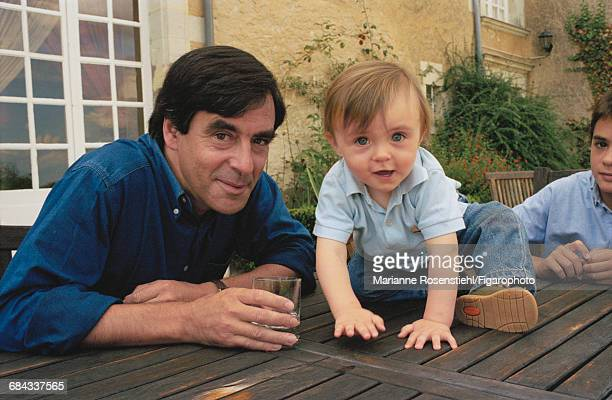 French politician François Fillon with his son Arnaud, 1st September 2002. Fillon is Minister of Social Affairs, Labour and Solidarity in the governnment of Jacques Chirac.