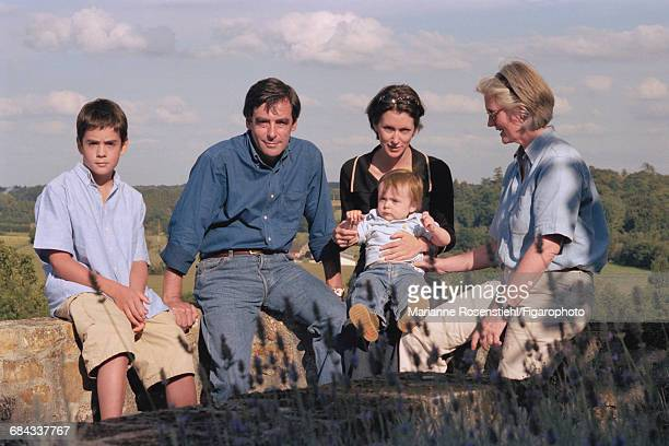 French politician François Fillon with his wife Penelope Clarke (right) and their children Marie, Edouard (left) and Arnaud (on Marie's lap), 1st September 2002. Fillon is Minister of Social Affairs, Labour and Solidarity in the governnment of Jacques Chirac.
