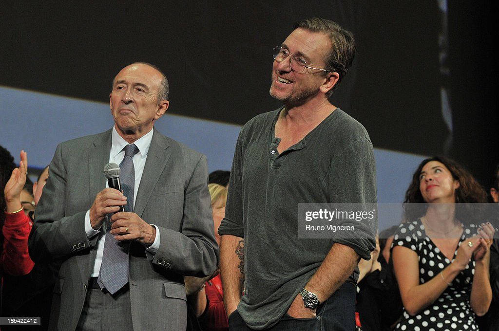 French politician Gerard Collomb (L) and actor Tim Roth on stage during the closing ceremony of 'Lumiere 2013, Grand Lyon Film Festival' on October 20, 2013 in Lyon, France.