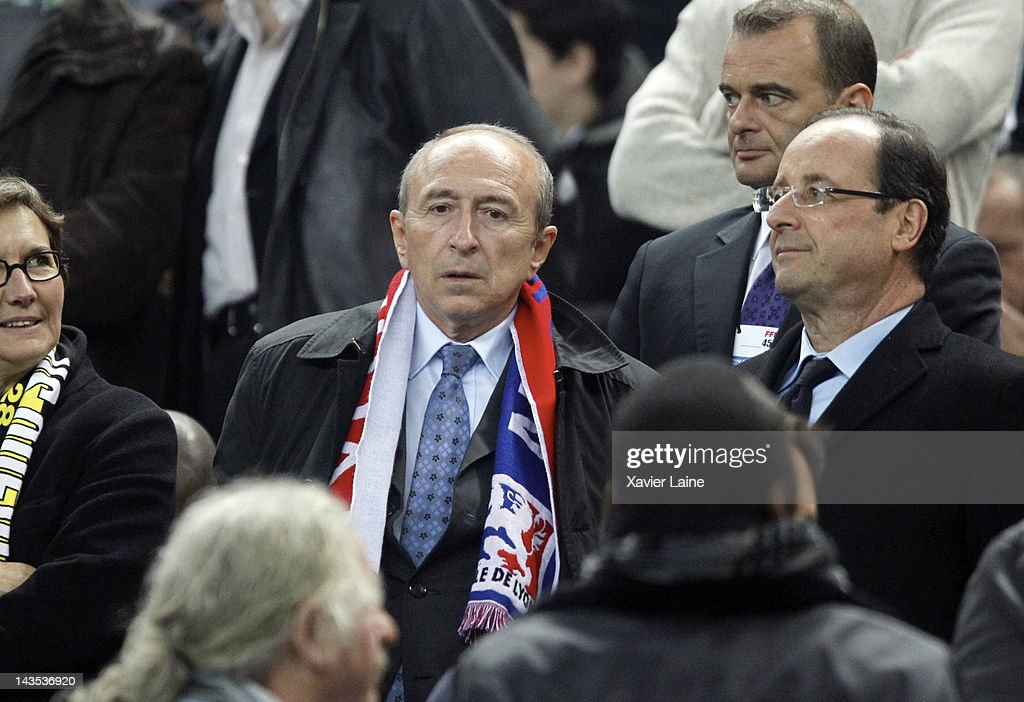 French Politician <a gi-track='captionPersonalityLinkClicked' href=/galleries/search?phrase=Gerard+Collomb&family=editorial&specificpeople=672969 ng-click='$event.stopPropagation()'>Gerard Collomb</a> and Francois Hollande attend the French Cup Final between Lyon Olympique and Quevilly US at Stade France on April 28, 2012 in Saint-Denis, France.