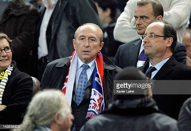 French Politician Gerard Collomb and Francois Hollande attend the French Cup Final between Lyon Olympique and Quevilly US at Stade France on April 28...