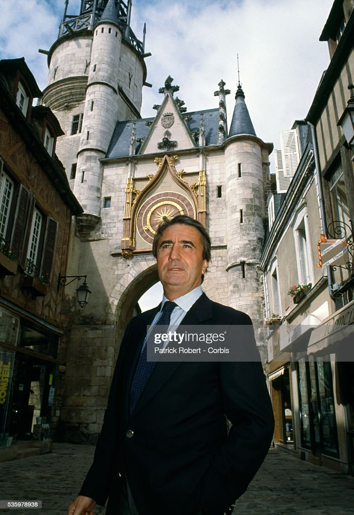 French politician Jean-Pierre Soisson stands near the Tour de l'Horloge, the clock tower in Auxerre.