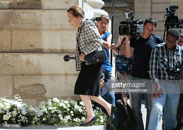 French politician MarieFrance Garaud walks past journalists as she arrives at the SaintThomas d'Aquin Church to attend the funeral ceremony of...