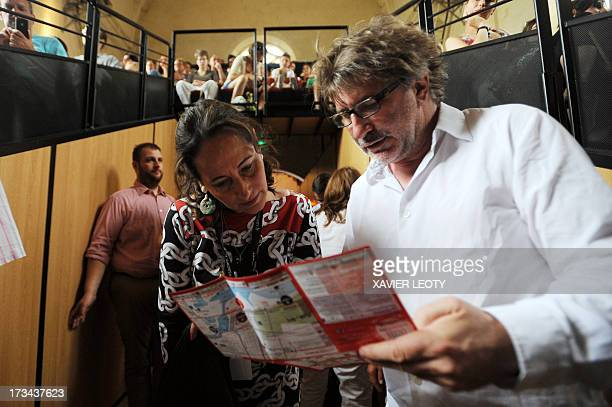 French politician Segolene Royal and Gerard Pont French director of the Francofolies music festival attend the performance of Mathieu Malzieu French...