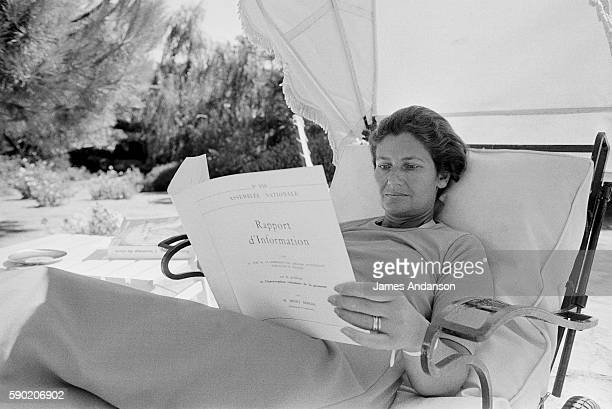 French politician Simone Veil reading a goverment document at home in Sainte Maxime France 10 August 1974