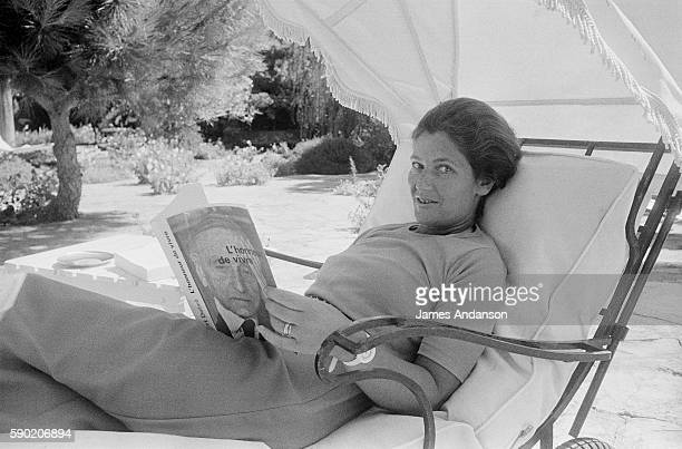 French politician Simone Veil reading at home in Sainte Maxime France 10 August 1974