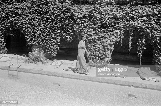 French politician Simone Veil walking by the swimming pool at her home in Sainte Maxime France 10 August 1974