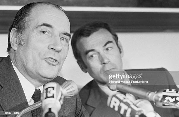French politicians Francois Mitterrand and Robert Badinter present the Socialist Party's 'Freedom Charter' at a meeting in Paris