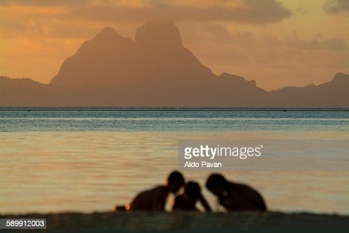 French Polynesia, boys in the beach