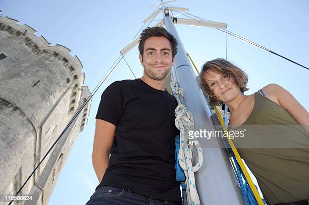 French pop band Cocoon members Mark Daumail and Morgane Imbeaud pose on a boat during a press conference off the French western city of La Rochelle...