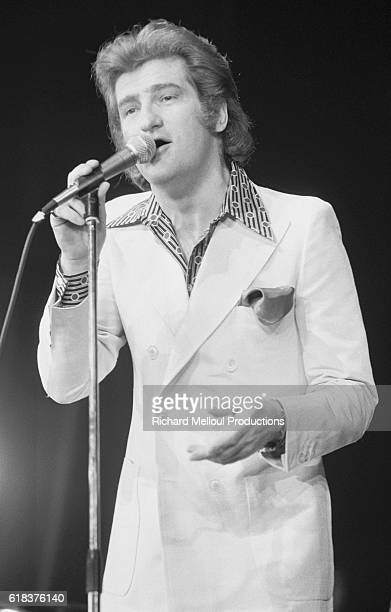 French pop singer Eddy Mitchell sings during his concert at the Olympia concert hall in Paris