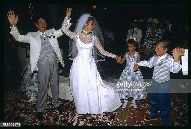 French pop singer Marc Lavoine and Sarah Poniatowski dance joyously with younger family members at their wedding reception in Morocco