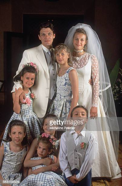 French pop singer Marc Lavoine and Sarah Poniatowski pose for a wedding photo with younger family members