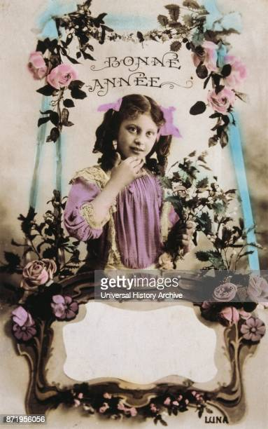 French postcard depicting a young girl with floral decorations 1900