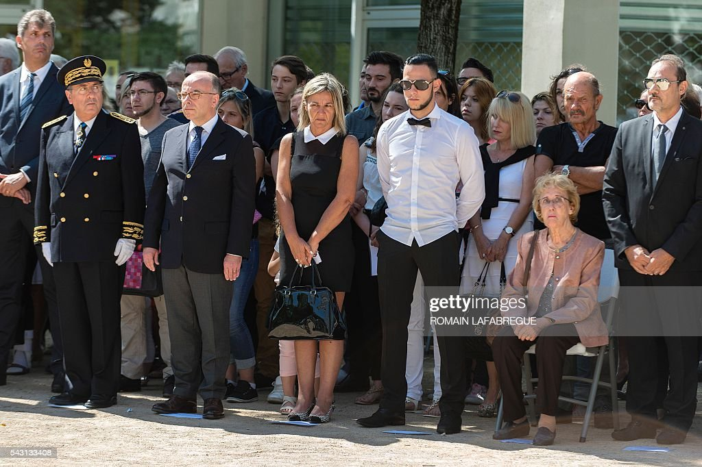 French prefect of Lyon Michel Delpuech, French Interior Minister Bernard Cazeneuve, Herve Cornara's wife Laurence, son Kevin, mother Lucete and brother Didier Cornara, attend a memorial ceremony on June 26, 2016 in Fontaines-sur-Saone, in tribute to Herve Cornara, killed one year ago in a terror attack at the Air Products factory in Saint-Quentin-Fallavier. In June, 2015, Yassin Salhi beheaded Herve Cornara, owner of a company where he had worked near Lyon. / AFP / ROMAIN
