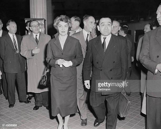 French premier Pierre MendesFrance is greeted by his wife on his arrival in Paris by train after a quick trip to Bagnoles de L'Orne France for a...