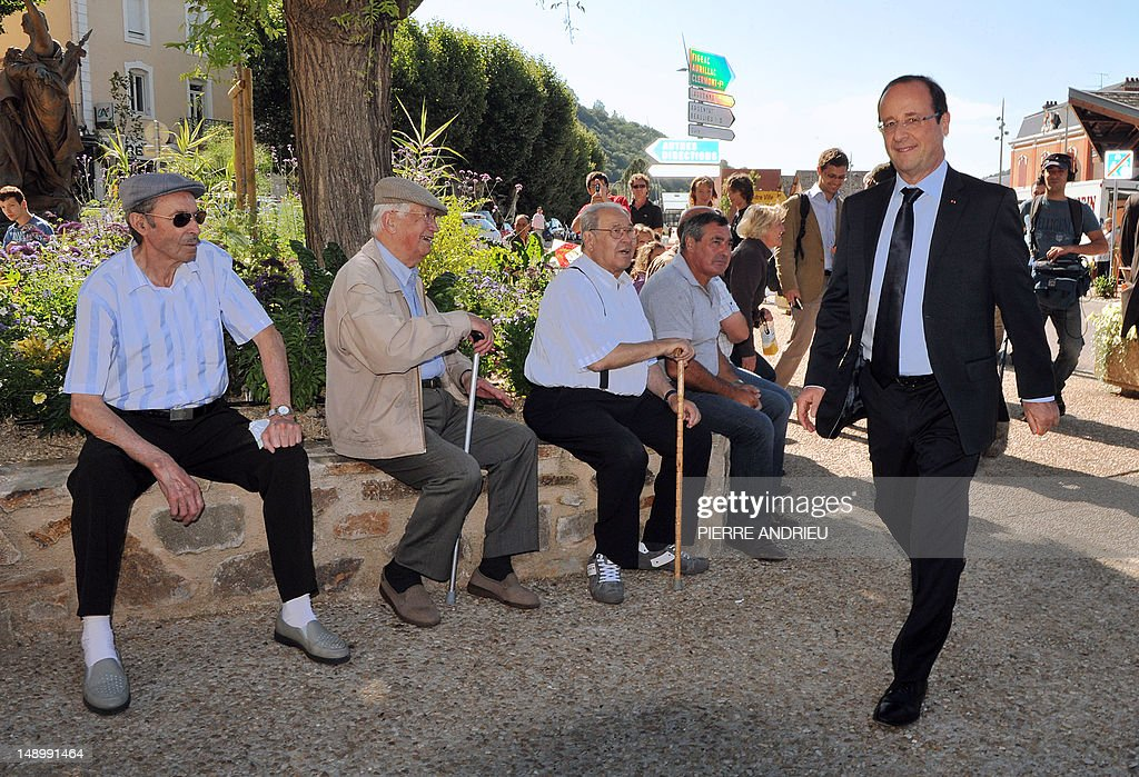 French President and former Socialist President of the Correze department General Council Francois Hollande leaves after visiting a market in his...