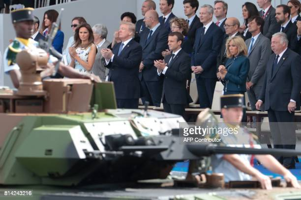 French President and Senate President Gerard Larcher wife of French President Brigitte Macron French President Emmanuel Macron US President Donald...