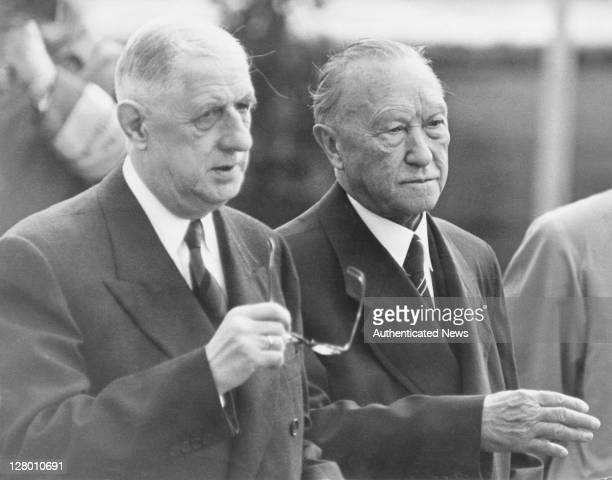 French President Charles De Gaulle is met by WestGerman Chancellor Konrad Adenauer at the airport in Bonn WestGermany at the start of an official...
