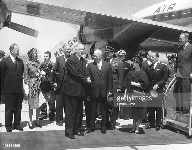 French President Charles de Gaulle shakes hands with US President Dwight Eisenhower on the tarmac at the airport Washongton DC April 22 1960