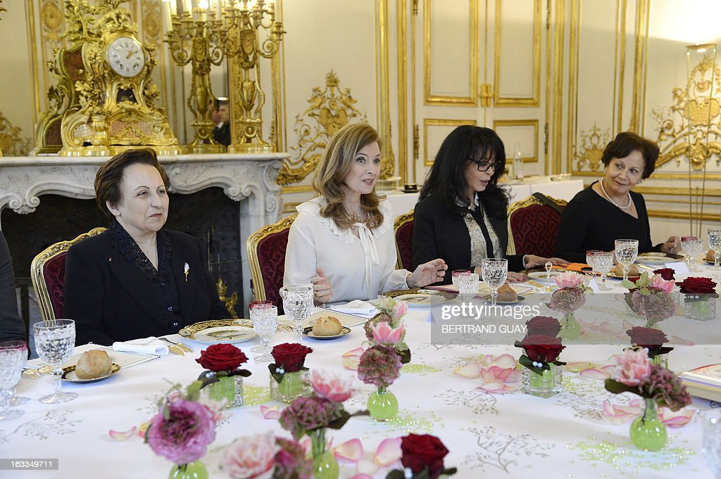 French president companion Valerie Trierweiler (2nd L), and junior minister for Francophony, Yamina Benguigui (3rd L), speaks before a lunch with Shirin Ebadi (L), Iranian lawyer and 2003 Nobel Prize for Peace laureate and Tunisian Souhayr Belhassen, president of the international federation for Human Rights. The lunch is held by Trierweiler to mark the Women's international day.