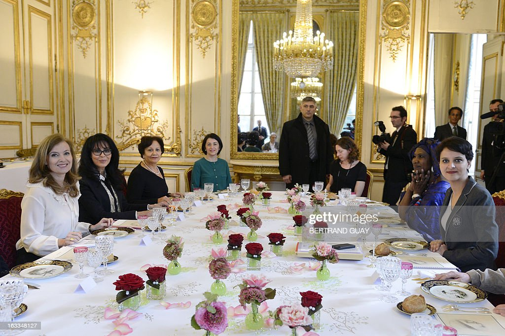 French president companion Valerie Trierweiler (L), minister for Women's Rights Najat Vallaud-Belkacem (R) and junior minister for Francophony, Yamina Benguigui (2nd L), pose before a lunch with Shirin Ebadi (3rd L), Iranian lawyer and 2003 Nobel Prize for Peace laureate, Ramata Coulibaly (2nd R) from the 'Malian from France for peace collectif', and Selma Fekih (4th L), Tunisian embassador in France's wife. The lunch is held by Trierweiler to mark the Women's international day.