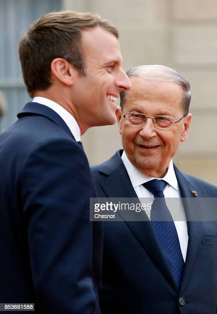 French President Emmanuel Macron accompanies Libanese President Michel Aoun after their meeting at the Elysee Presidential Palace on September 25...