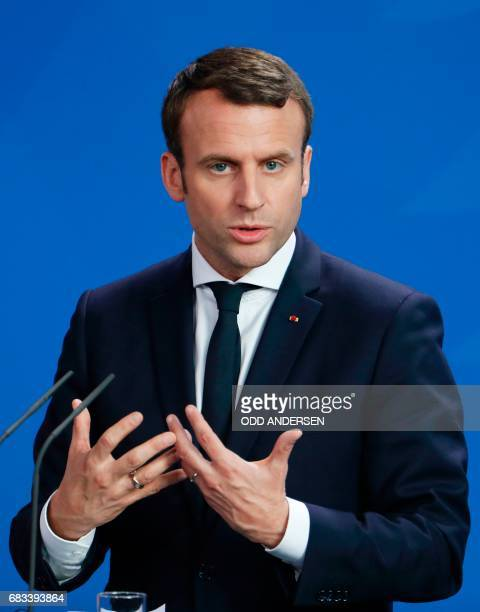 French President Emmanuel Macron addresses a press conference with the German Chancellor after their talks on May 15 2017 at the chancellery in...