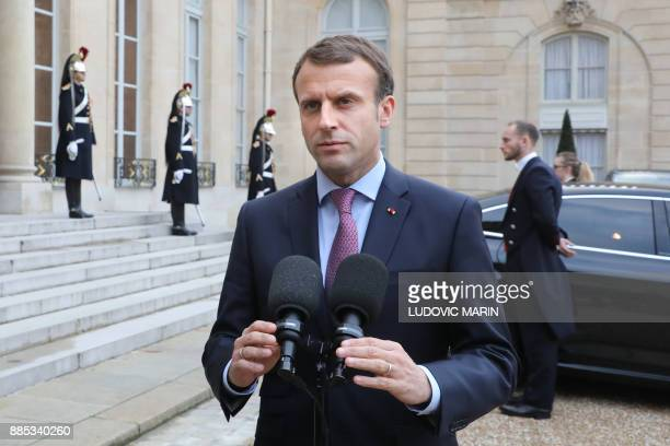 French president Emmanuel Macron addresses the media following a meeting with his Bulgarian counterpart on December 4 2017 at the Elysee palace in...
