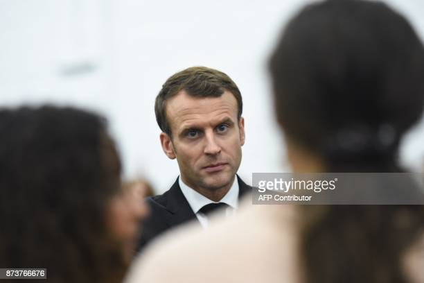 French President Emmanuel Macron addresses young members of the cultural space 'La condition publique' in Roubaix northern France on November 13 as...