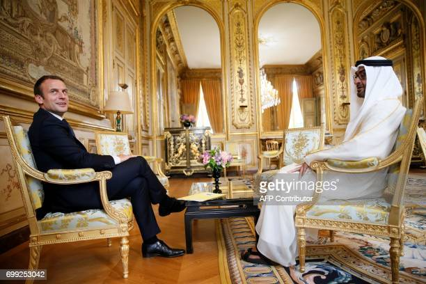 French President Emmanuel Macron and Abu Dhabi's Crown Prince Sheikh Mohammed bin Zayed alNahyan speak before a meeting at The Elysee Palace in Paris...