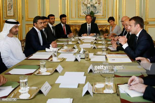 French President Emmanuel Macron and Abu Dhabi's Crown Prince Sheikh Mohammed bin Zayed alNahyan speak during a meeting at The Elysee Palace in Paris...
