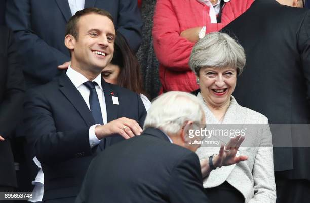 French President Emmanuel Macron and British Prime Minister Theresa May look on from the stands prior to the International Friendly match between...