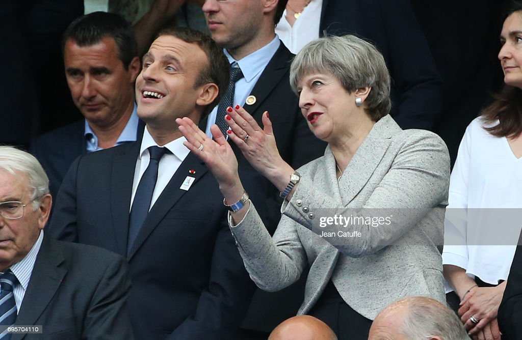 French President Emmanuel Macron and British Prime Minister Theresa May during the international friendly match between France and Englan at Stade de France on June 13, 2017 in Saint-Denis near Paris, France.