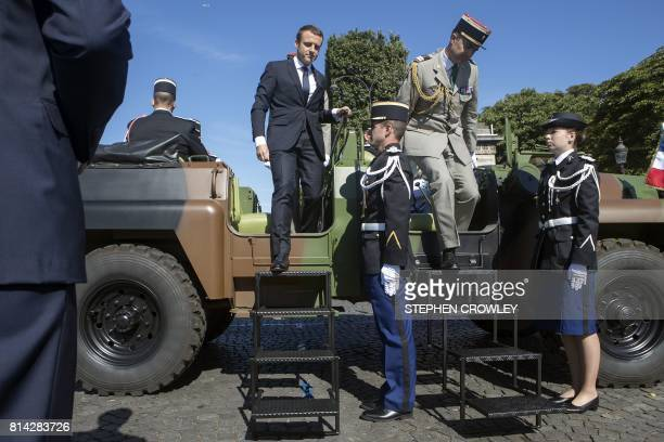 French President Emmanuel Macron and Chief of the Defence Staff French Army General Pierre de Villiers step down from a command car during the...