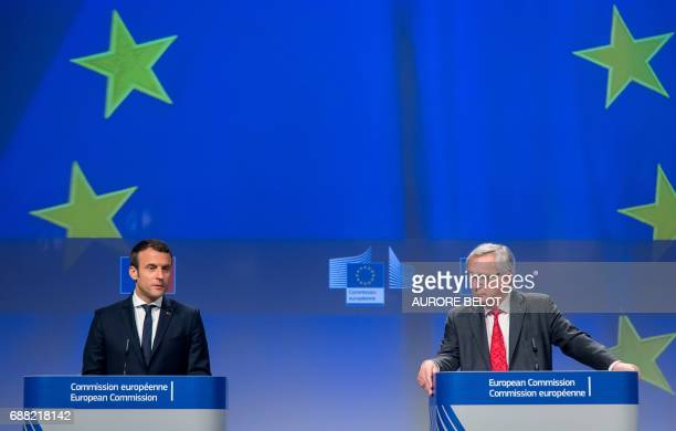 French President Emmanuel Macron and European Commission President JeanClaude Juncker give a press conference during their meeting at the European...