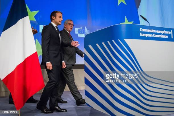 French President Emmanuel Macron and European Commission President JeanClaude Juncker arrive to give a press conference during their meeting at the...