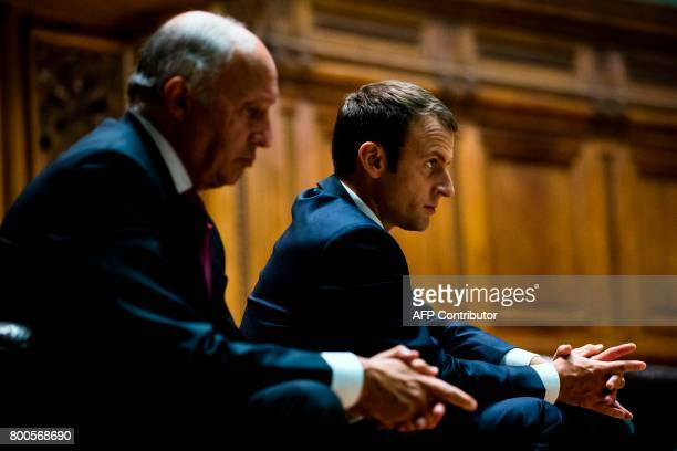 French President Emmanuel Macron and former French Foreign Minister Laurent Fabius attend the World Environment Pact meeting at the Sorbonne...