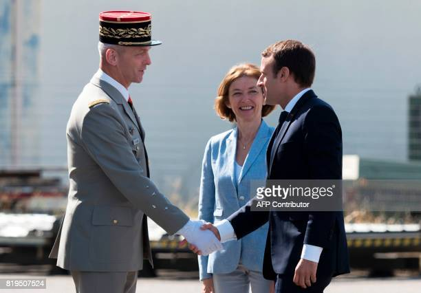 French President Emmanuel Macron and French Defence Minister Florence Parly are greeted by newly appointed French chief of military staff General...