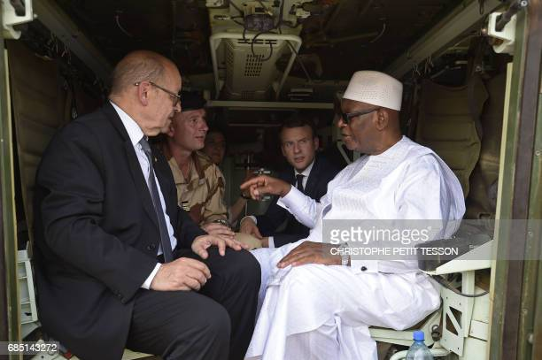 French President Emmanuel Macron and French Foreign Affairs Minister JeanYves Le Drian talk with Mali's President Ibrahim Boubacar Keita inside a...